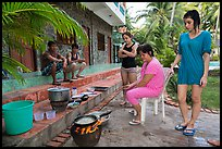 Vacationers frying fish in resort. Mui Ne, Vietnam (color)