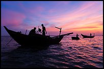 Fishermen on boats at sunset. Mui Ne, Vietnam (color)