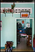 House interior with altars and picture. Mui Ne, Vietnam (color)