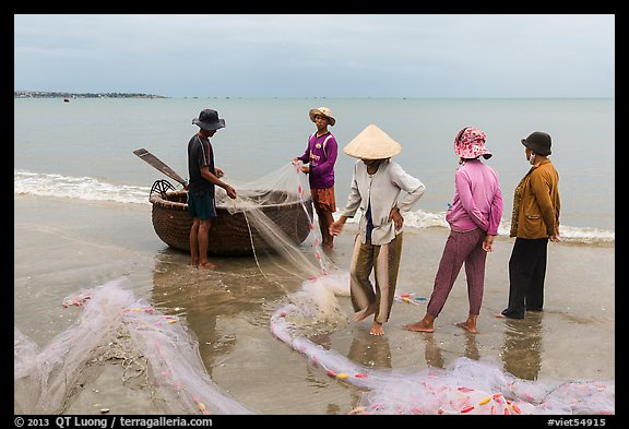 Fishermen, net, and coracle boat. Mui Ne, Vietnam (color)