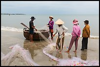 Fishermen, net, and coracle boat. Mui Ne, Vietnam ( color)