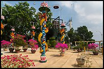 Sculptures of Chinese dragons at Temple of the Coconut Monk. My Tho, Vietnam ( color)