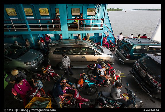 Abord ferry across the Mekong River. Mekong Delta, Vietnam (color)