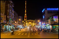 Main street and telecomunication tower at night. Tra Vinh, Vietnam ( color)