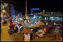 Street market and telecomunication tower at night. Tra Vinh, Vietnam ( color)