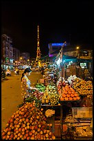 Fruit vendor on main street at night. Tra Vinh, Vietnam ( color)