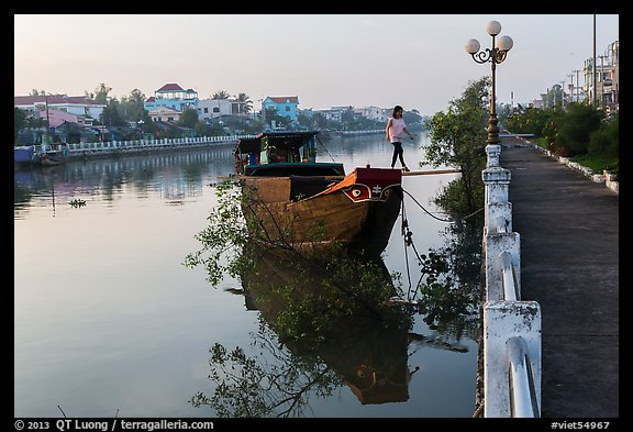 Woman in high heels walking out of barge. Tra Vinh, Vietnam (color)