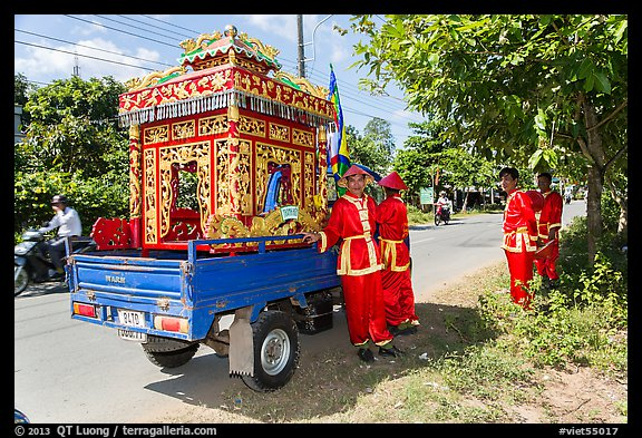 Funeral vehicle and attendants. Tra Vinh, Vietnam (color)