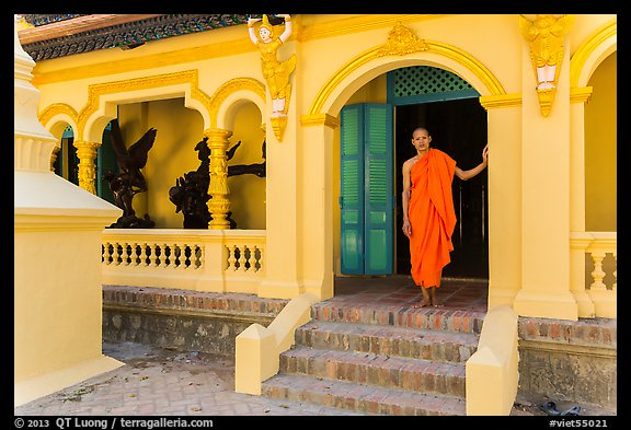 Monk standing in front of Ang Pagoda. Tra Vinh, Vietnam (color)