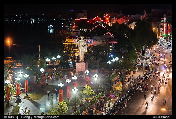 Mekong River, Ho Chi Minh statue, and street at night. Can Tho, Vietnam (color)