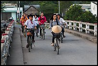 Children bike on way to school, Phung Diem. Can Tho, Vietnam (color)