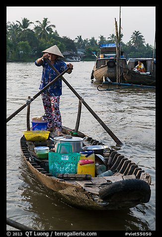 Woman paddles boat with pho noodles, Phung Diem. Can Tho, Vietnam (color)
