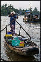 Woman paddles boat with pho noodles, Phung Diem. Can Tho, Vietnam ( color)