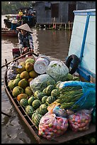 Woman paddles boat fully loaded with produce, Phung Diem. Can Tho, Vietnam ( color)