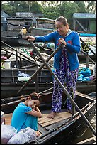 Woman and girl, Phung Diem floating market. Can Tho, Vietnam ( color)