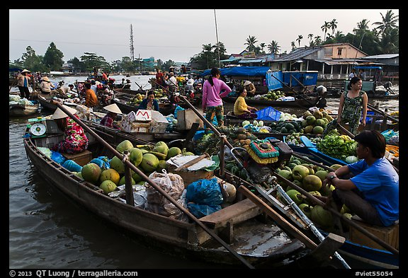 Boats closely decked together, Phung Diem floating market. Can Tho, Vietnam (color)