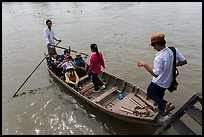 Schoolchildren stepping onto boat. Can Tho, Vietnam ( color)