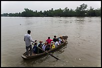 Schoolchildren crossing river on boat. Can Tho, Vietnam ( color)