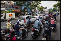 Dense motorcycle traffic. Ho Chi Minh City, Vietnam ( color)