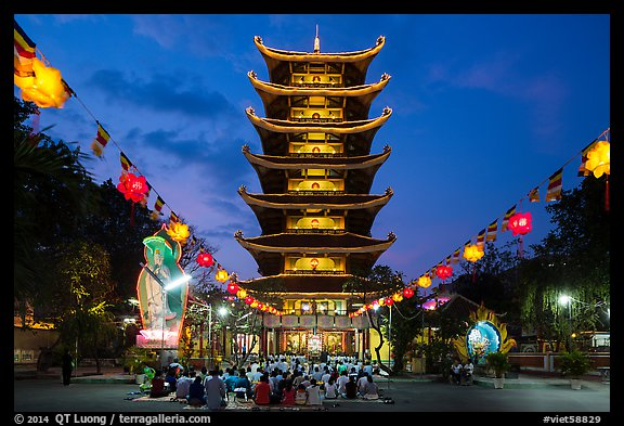 Evening worship at Viet Nam Quoc Tu pagoda. Ho Chi Minh City, Vietnam (color)