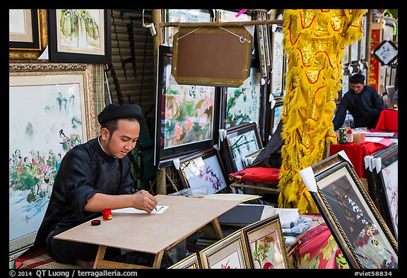 Caligraphers at lunar new year market. Ho Chi Minh City, Vietnam (color)