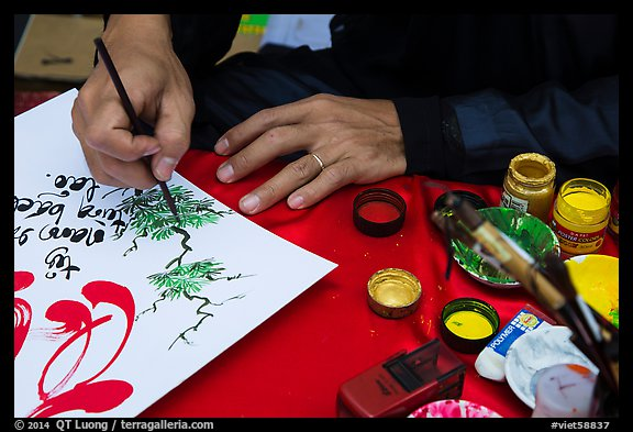 Hands drawing Tet greetings. Ho Chi Minh City, Vietnam (color)