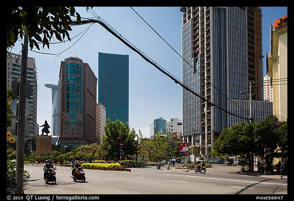 Statue of hero Tran Hung Dao and high-rises. Ho Chi Minh City, Vietnam (color)