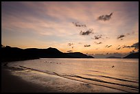 Con Son Beach with people in water before sunrise. Con Dao Islands, Vietnam ( color)