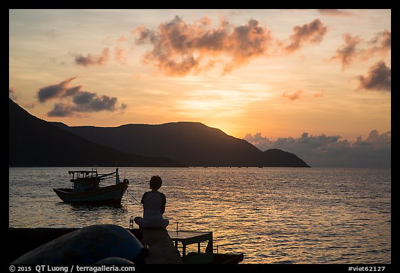 Silhouetted woman watching sunrise from Wharf 914, Con Son. Con Dao Islands, Vietnam (color)