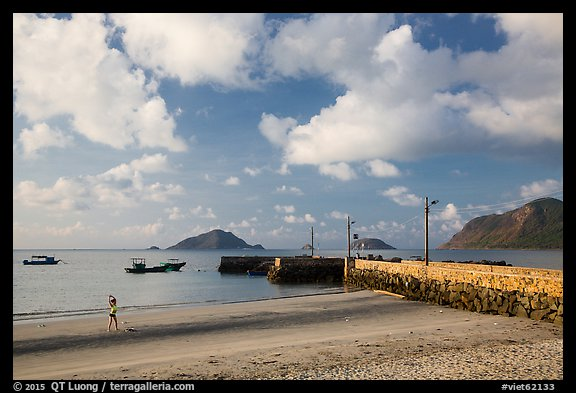 Beach with woman exercising, Con Son. Con Dao Islands, Vietnam (color)