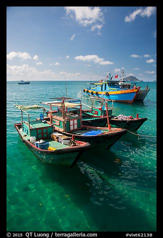 Fishing boats floating on clear water, Con Son. Con Dao Islands, Vietnam (color)