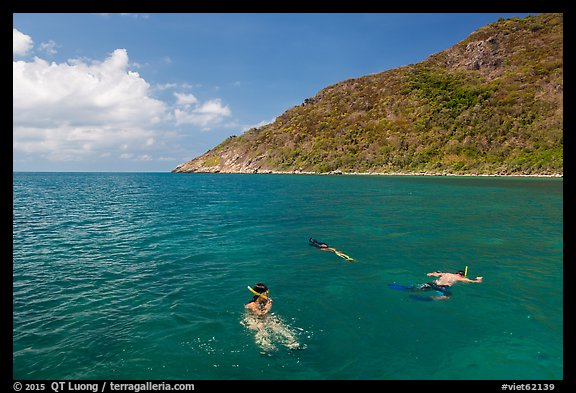 Snorklers near Bay Canh Island, Con Dao National Park. Con Dao Islands, Vietnam (color)