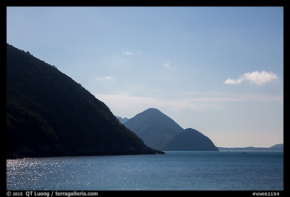 Hills plunging in sea, Bay Canh Island, Con Dao National Park. Con Dao Islands, Vietnam (color)