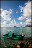 Fisherman lifting anchor from boat, Con Son. Con Dao Islands, Vietnam ( color)