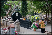 Woman pays respect to Vo Thi Sau grave. Con Dao Islands, Vietnam ( color)