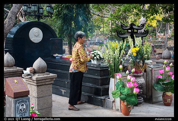 Woman offers incense at Vo Thi Sau grave. Con Dao Islands, Vietnam (color)
