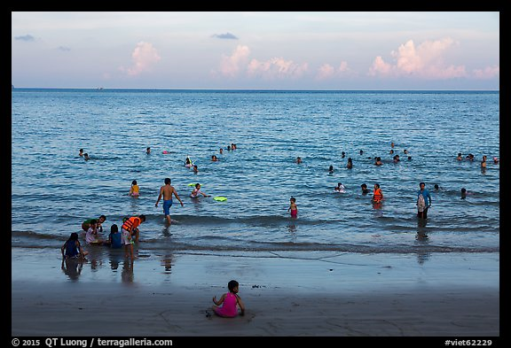 Beachgoers at sunset, Con Son. Con Dao Islands, Vietnam (color)