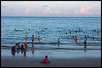 Beachgoers at sunset, Con Son. Con Dao Islands, Vietnam ( color)