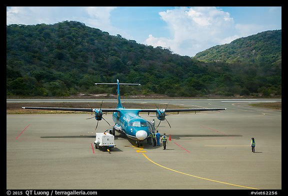 Turboprop plane and airport. Con Dao Islands, Vietnam (color)