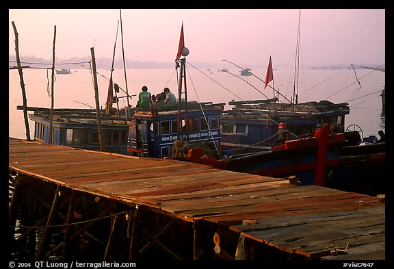 Pier and fishing boats, Nhat Le River, Dong Hoi. Vietnam (color)