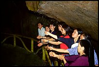 Women catch the water seeping from Tan Thanh Cave, said to have mirculous properties. Lang Son, Northest Vietnam ( color)
