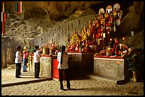 Women praying at the altar at the entrance of Tan Thanh Cave. Lang Son, Northest Vietnam