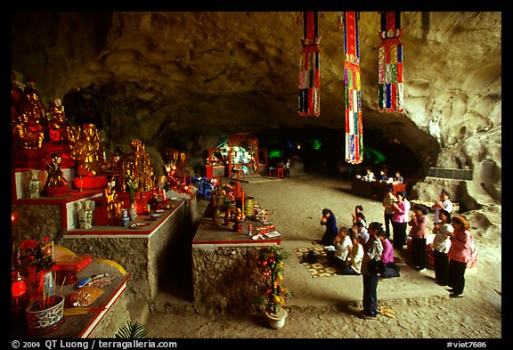 Group praying at the altar at the entrance of Tan Thanh Cave. Lang Son, Northest Vietnam (color)