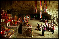 Group praying at the altar at the entrance of Tan Thanh Cave. Lang Son, Northest Vietnam ( color)