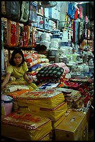 Vendor sitting amongst Abondance of cheap goods imported from nearby China at the Dong Kinh Market. Lang Son, Northest Vietnam ( color)