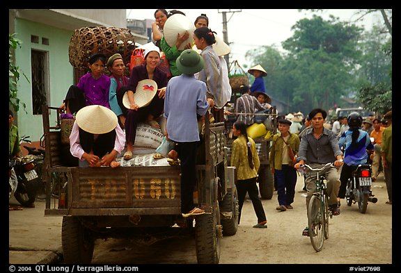 Riding in the back of an overloaded truck. Northest Vietnam (color)