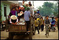 Riding in the back of an overloaded truck. Northest Vietnam