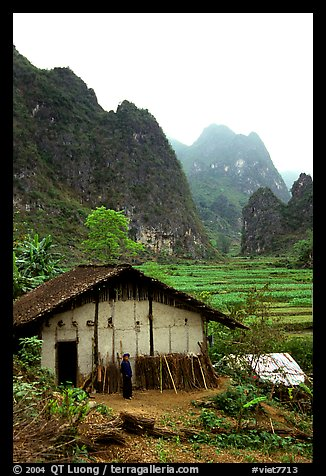 Rural home, terraced cultures, and karstic peaks, Ma Phuoc Pass area. Northeast Vietnam (color)