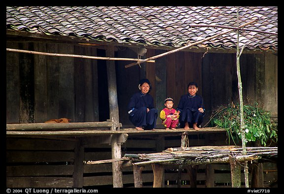 Women and child of the Nung ethnicity in front of their home. Northeast Vietnam (color)