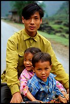 Young man carrying two kids on his bicycle. Northeast Vietnam
